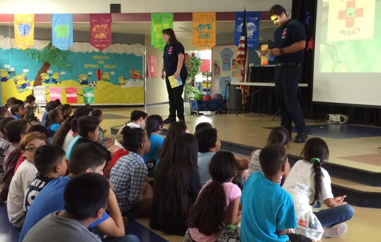 Lisa La Russo and Armando Reyes teach water safety tips to children at John Stallings Elementary in Corona, California.