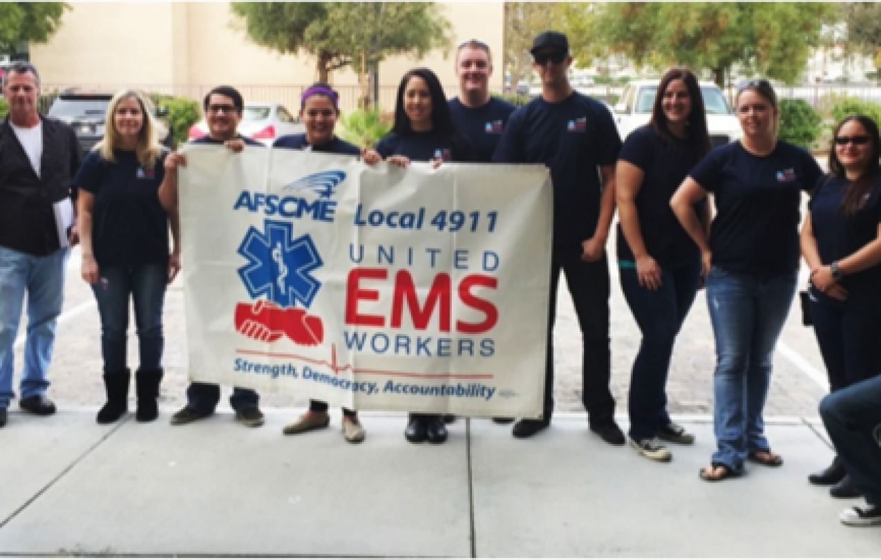 Members of United EMS Workers-AFSCME Local 4911 gather before delivering petition to AMR demanding respect. Photo Credit: Ashley Mates